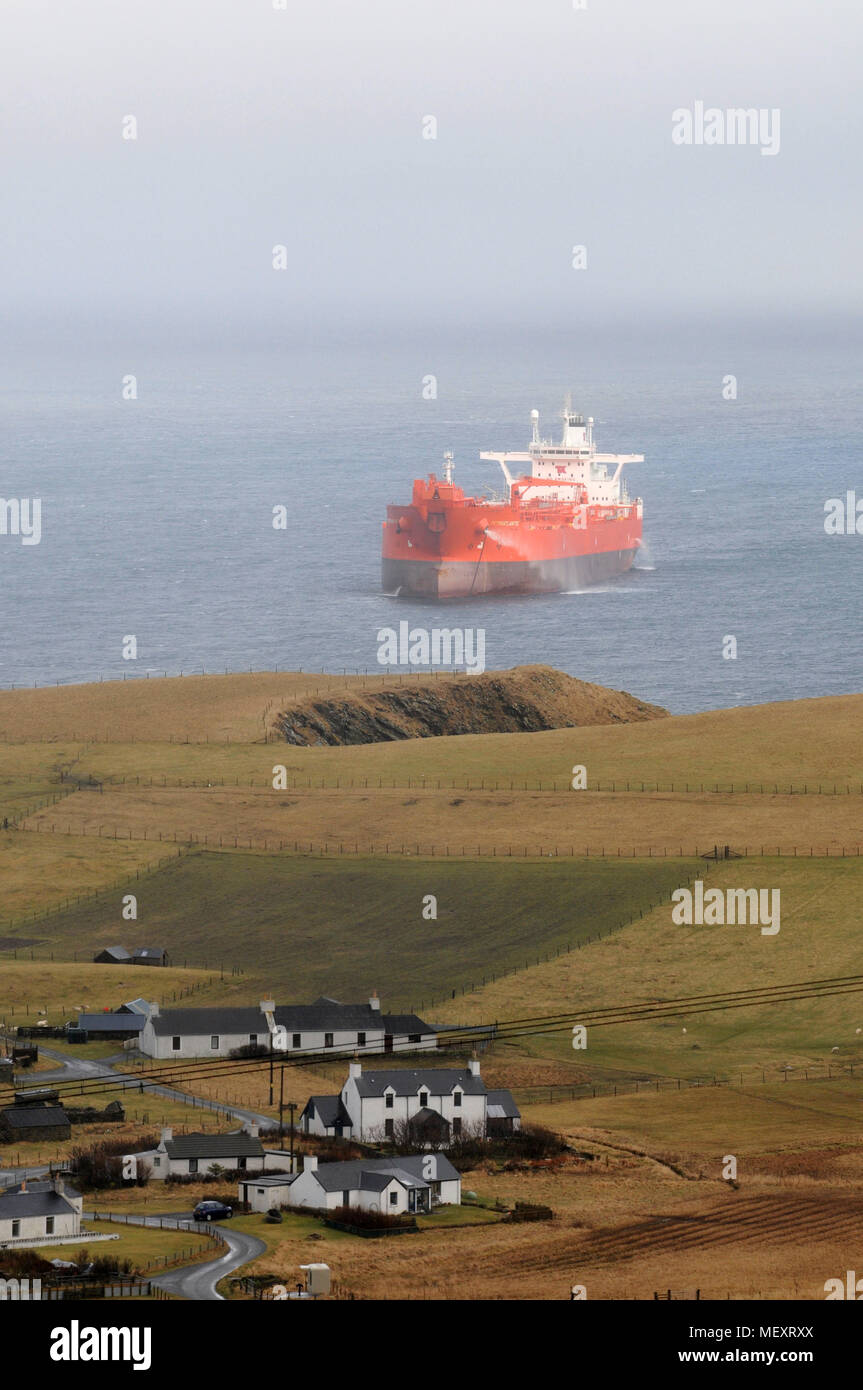 Oil Tanker anchored off the coast of Shetland waiting for orders - Stock Image
