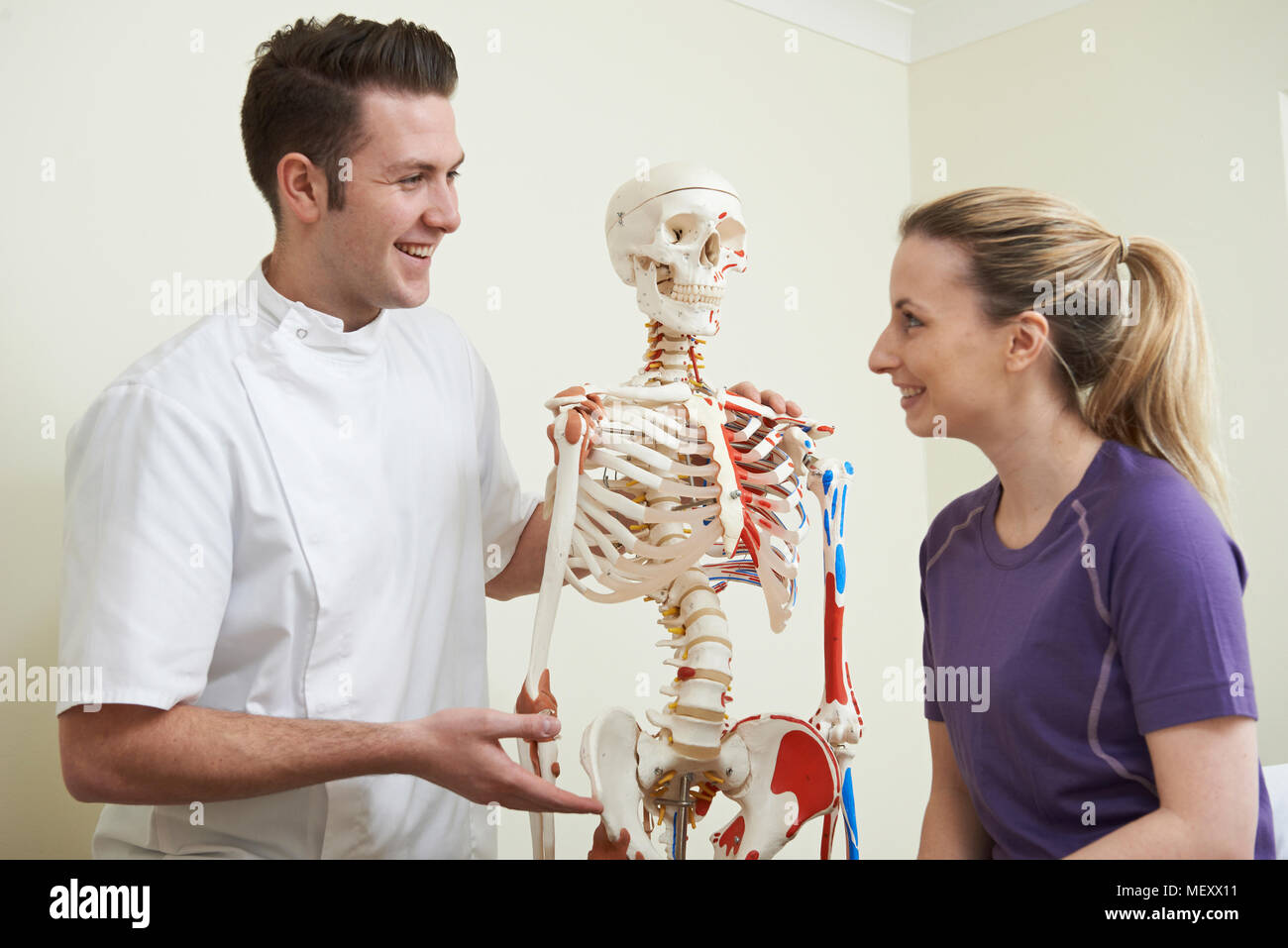 Female Patient In Consultation With Osteopath - Stock Image