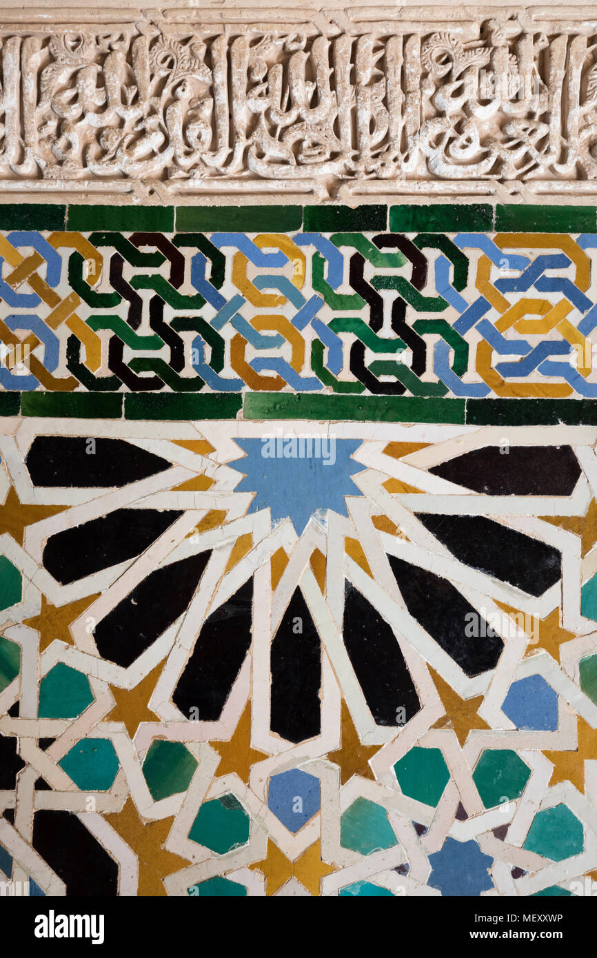 Islamic geometrical designs on wall tiles, The Alhambra, Granada, Andalucia, Spain, Europe - Stock Image