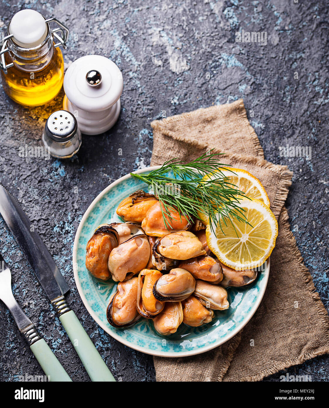 Marinated mussels with lemon and spices - Stock Image