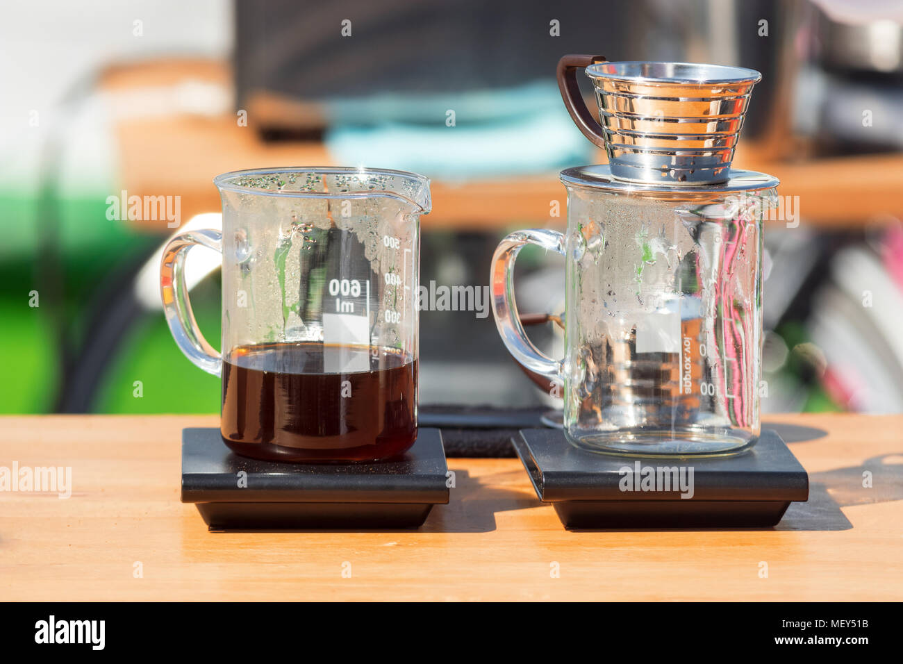 Making pour over coffee at the street market. Rge glass cups with dripper and filter - Stock Image