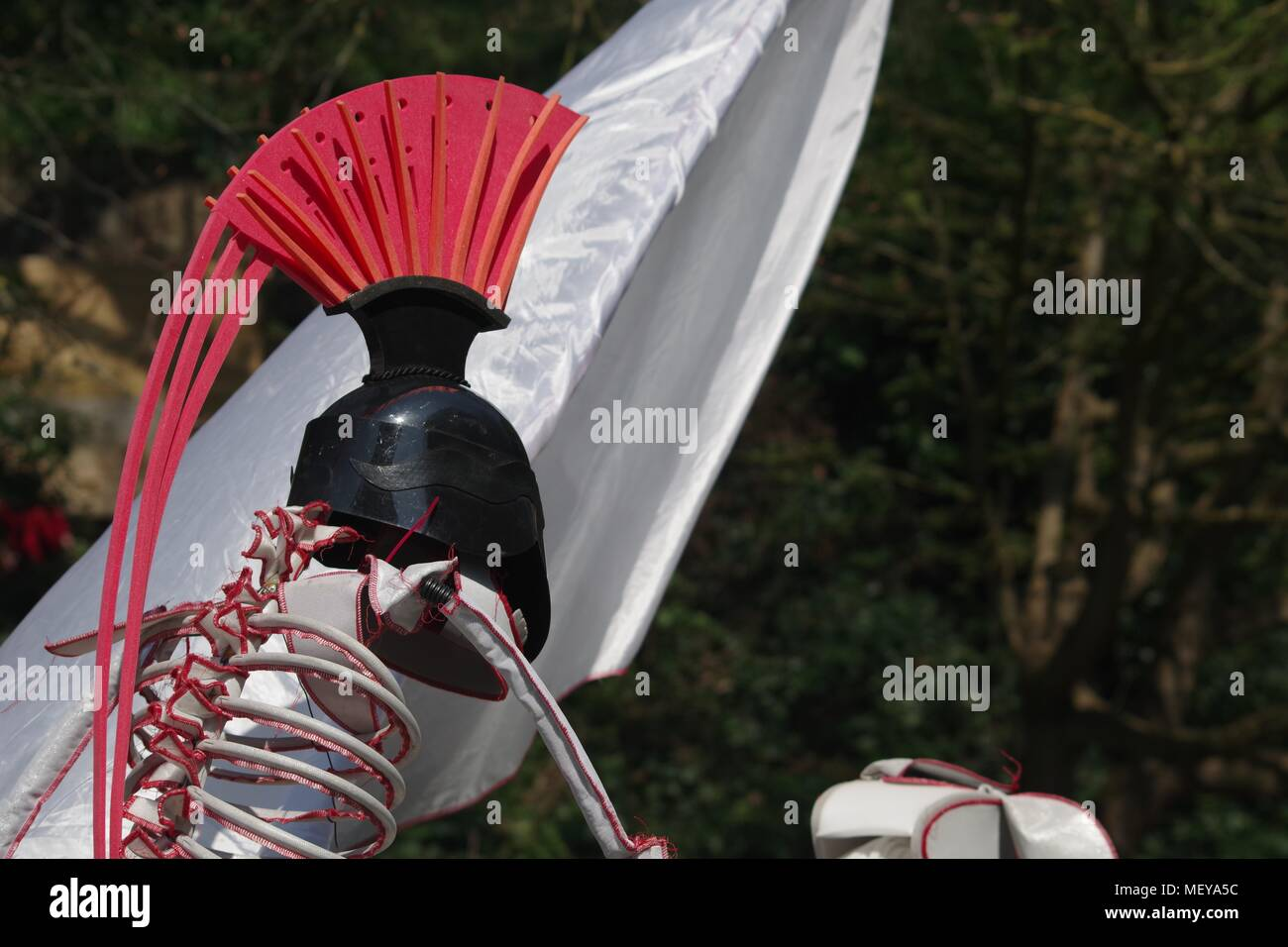 Roman Horse and Rider Skeleton Puppet with White Silky Banner at ramm's Carnival of the Animals in Rougemont Gardens. Exeter, Devon, UK. April, 2018. - Stock Image