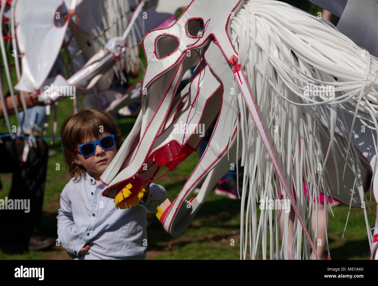 Child Strokes Horse and Rider Skeleton Puppet at ramm's Carnival of the Animals in Rougemont Gardens. Exeter, Devon, UK. April, 2018. - Stock Image