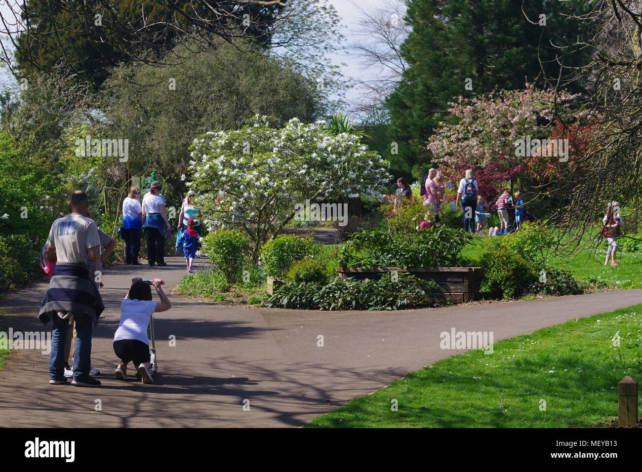 British Families Walking in the Park on a Spring Day. Rougemont Gardens, Exeter, Devon, UK. April, 2018. - Stock Image