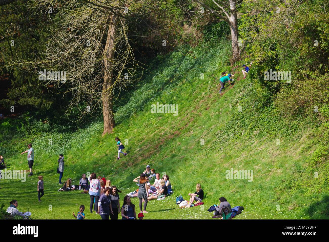Children Climbing the Old Castle Moat Embankment in Rougemont Gardens at RAMM's Carnival of the Animals Event. Exeter, Devon, UK. April, 2018. - Stock Image
