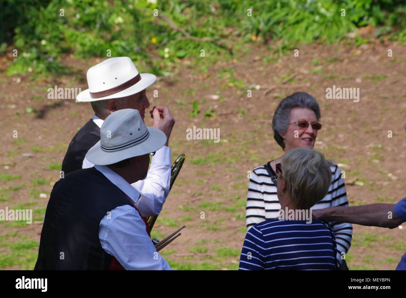 Elderly People Talking in Rougemont Garden at RAMM's Carnival of the Animals Anniversary. Exeter, Devon, UK. April, 2018. - Stock Image