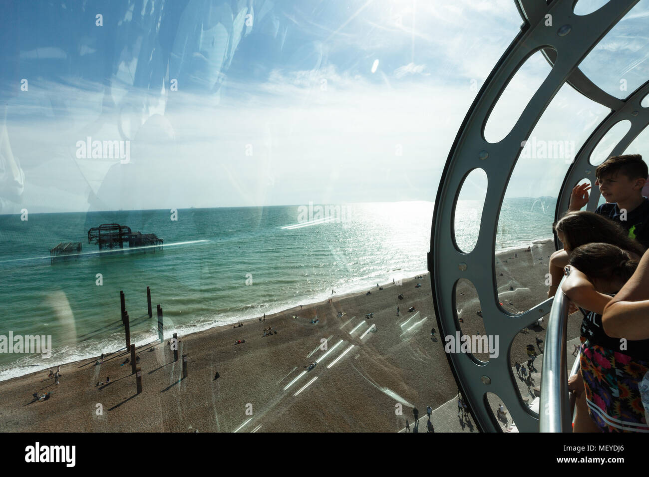 visitors enjoy the view of Brighton coastline from a bird's-eye view - Stock Image