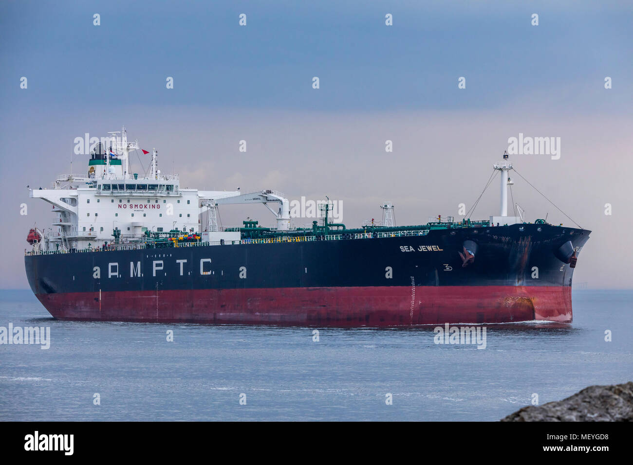Crude oil tanker A.M.P.T.C-Sea Jewel, entering the port of Ijmuiden, in North Holland, Netherlands, - Stock Image