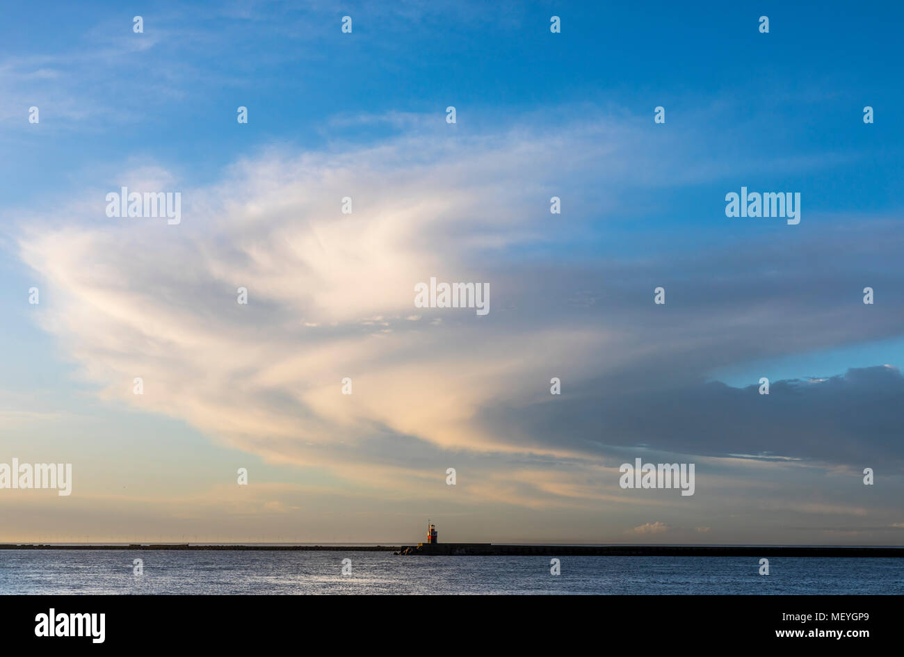 Harbor entrance of Ijmuiden in North Holland, Netherlands, cloud swirls, sea sign, - Stock Image