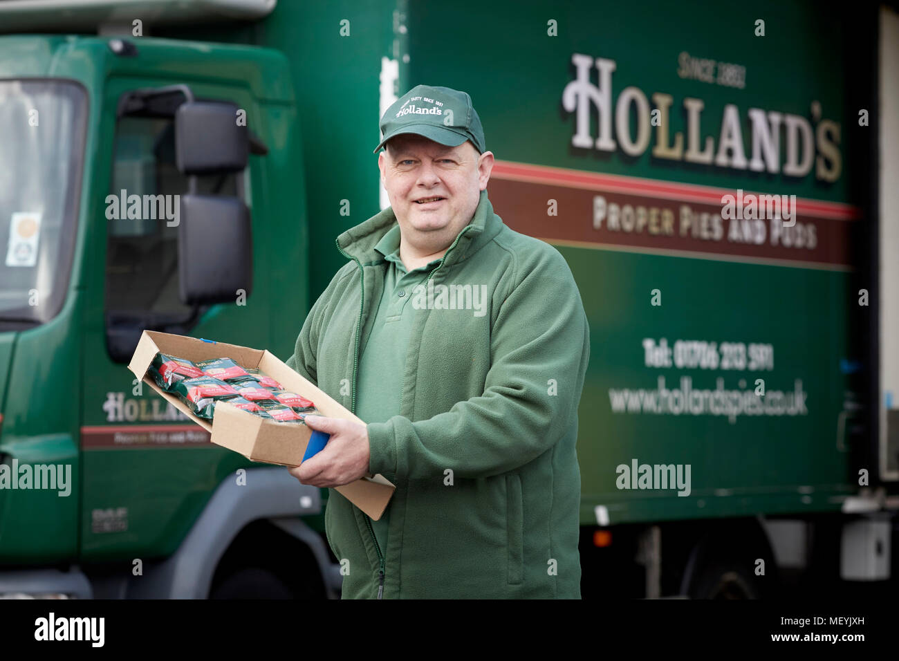 Hollands pies celebrate National Pie Week by dropping of donations of pies to charities nominated by the public.  Pictured pies being loaded onto the  - Stock Image