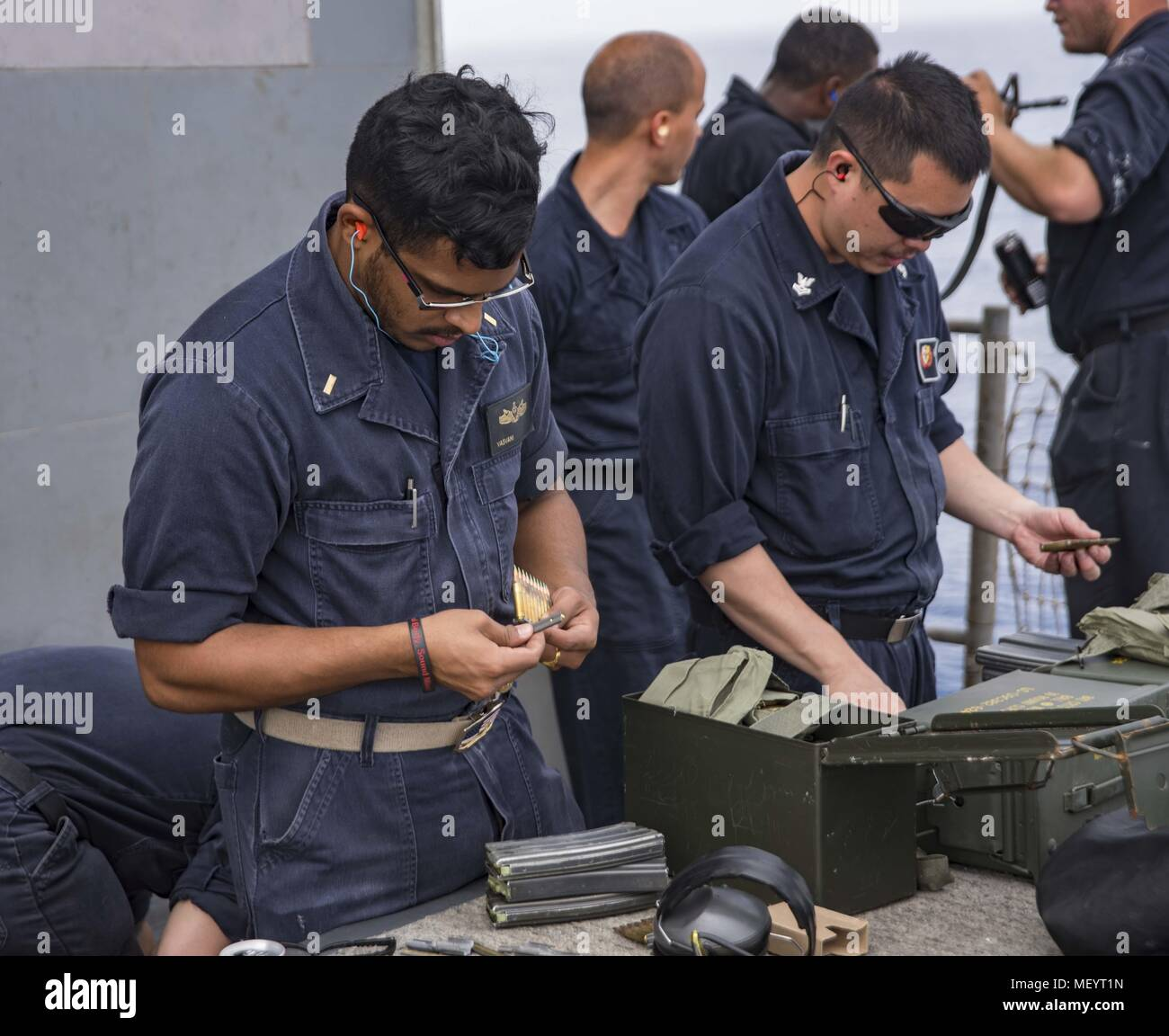 180418-N-DO281-0281 MEDITERRANEAN SEA (April 18, 2018) Ensign Nikunj Vasvani, left, and Fire Controlman 2nd Class Michaeel Lau, right, load magazines during a live-fire exercise aboard the guided-missile cruiser USS Monterey (CG 61), April 18, 2018. Monterey, home-ported in Norfolk, Virginia, is conducting operations in the U.S. 6th Fleet area of operations in support of U.S. national security interest in Europe. (U.S. Navy photo by Mass Communication Specialist Seaman Trey Fowler). () Stock Photo