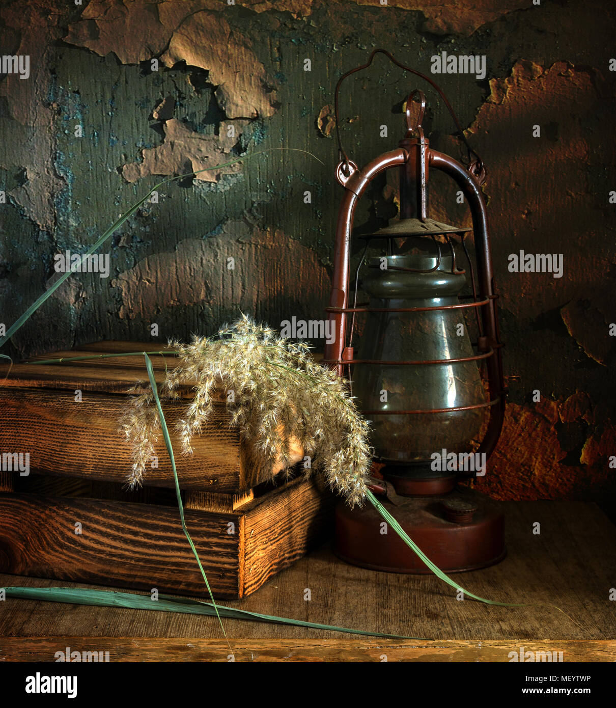 Vintage still life with a box and a kerosene lamp. - Stock Image
