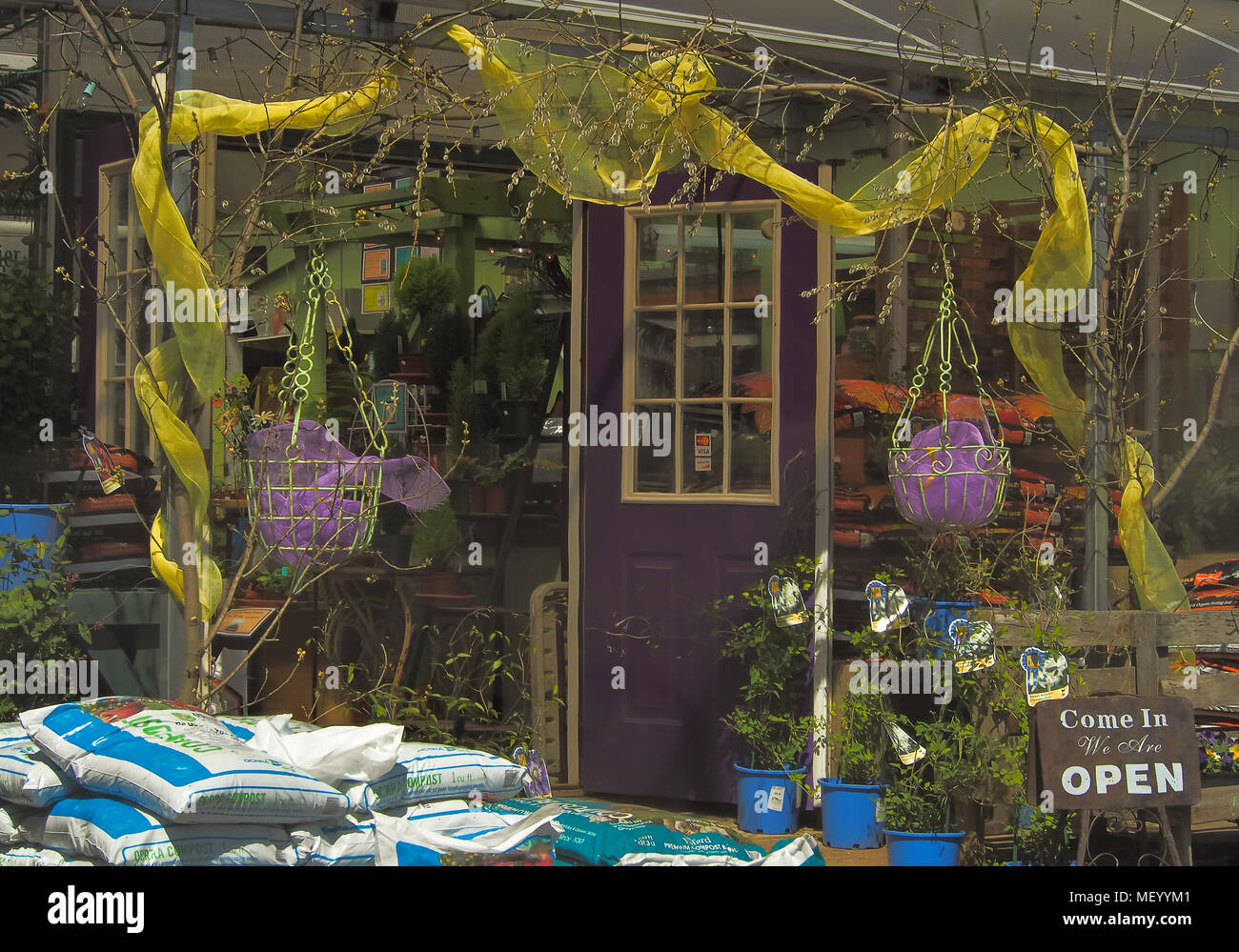 decorative yellow fabric draped over a garden shop entrance Stock ...