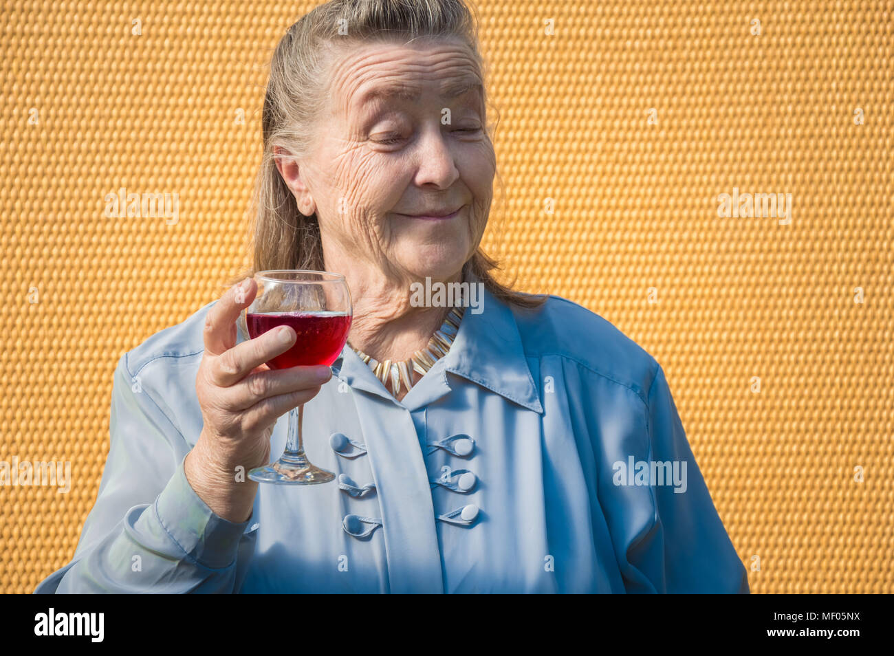 portrait of old farmer, businesswoman, grandmother outdoors at s Stock Photo