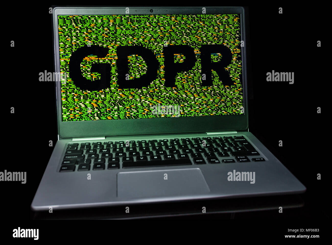 GDPR text outlined in database code on a laptop screen. - Stock Image