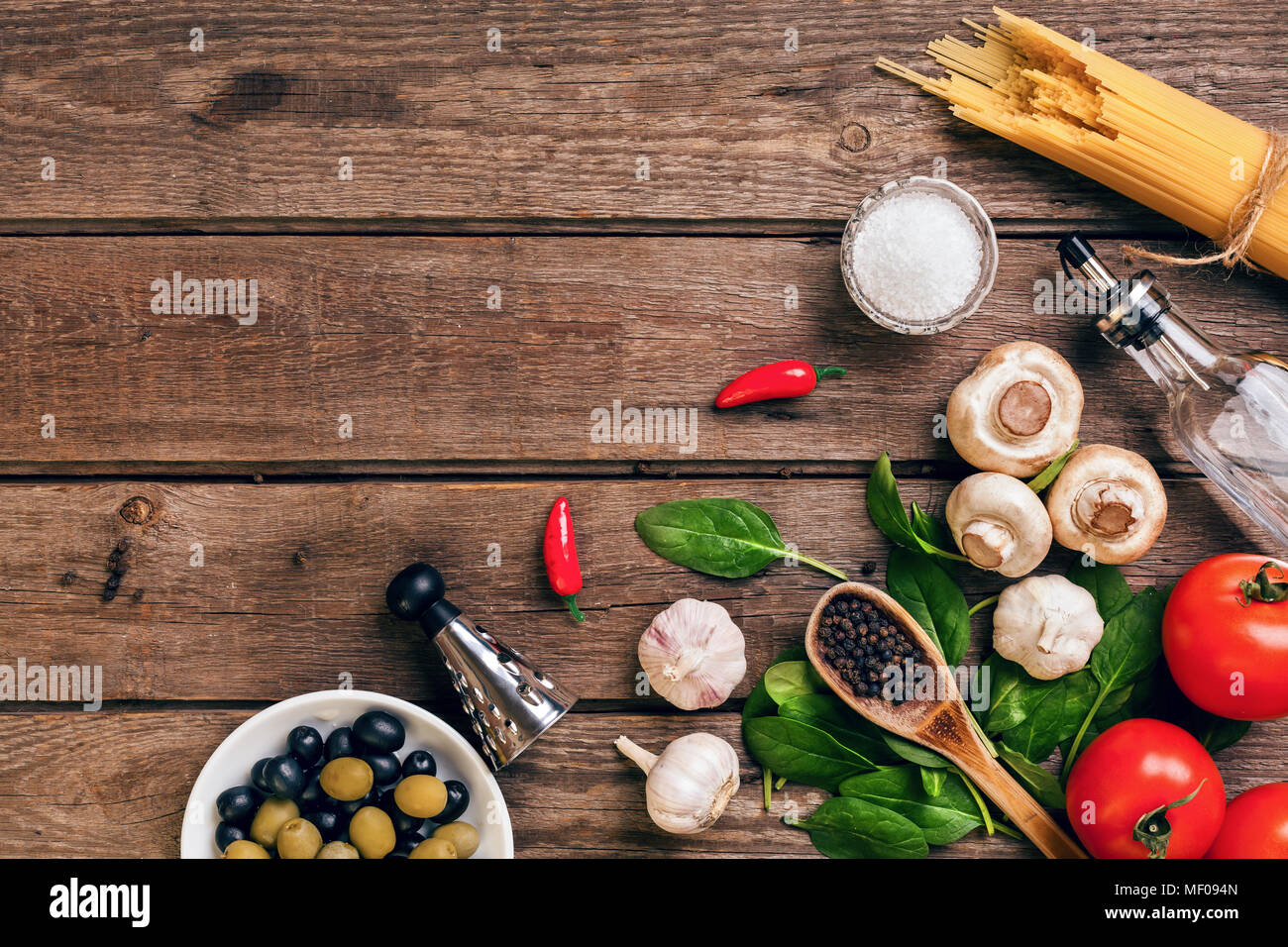 Italian food ingredients for the preparation pasta on wooden background - Stock Image
