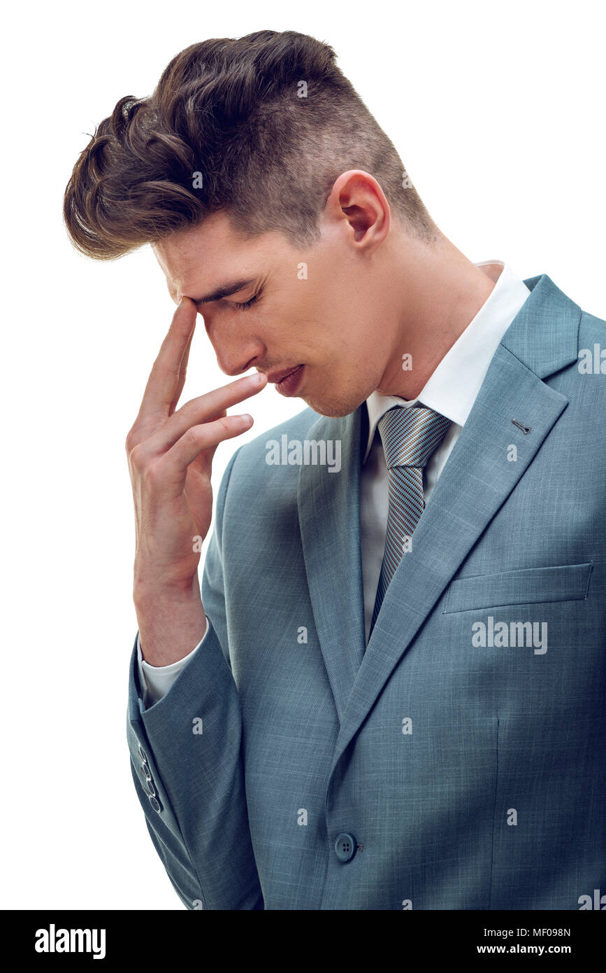 Frustrated overworked businessman worries about business problems, holding his finger on his forehead, isolated on white background. - Stock Image
