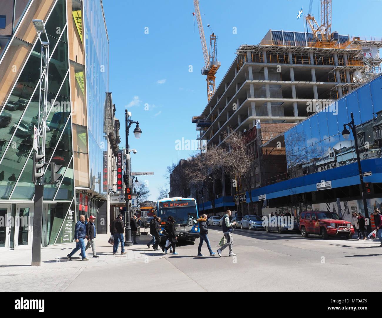 Corner of Sainte-Catherine street and Saint-Laurent boulevard in downtown Montreal - Stock Image