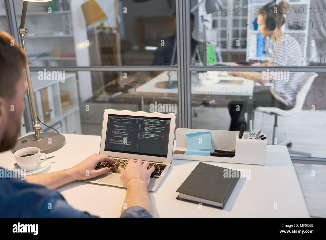 Coding on laptop - Stock Image