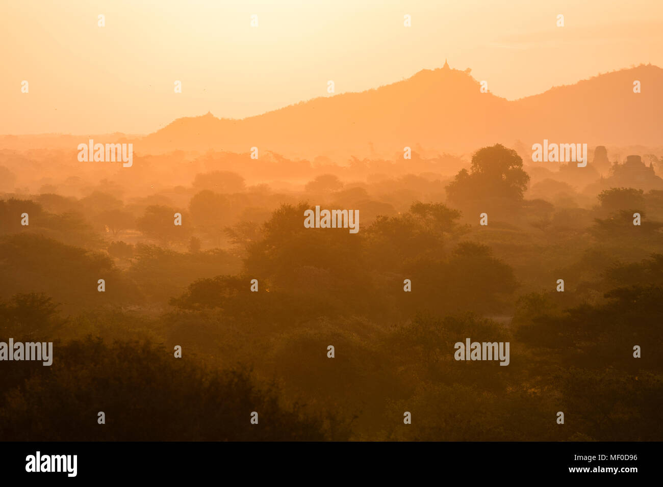 Scenic Sunrise over plain of Bagan on a misty morning, Myanmar Stock Photo