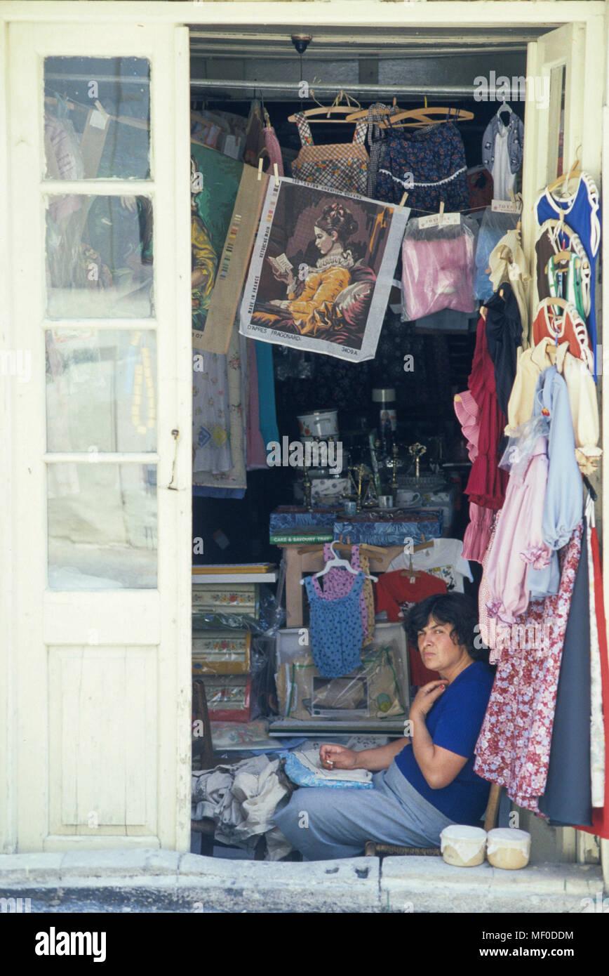 Women in the door of her shop with needlework 2000 Cyprus - Stock Image