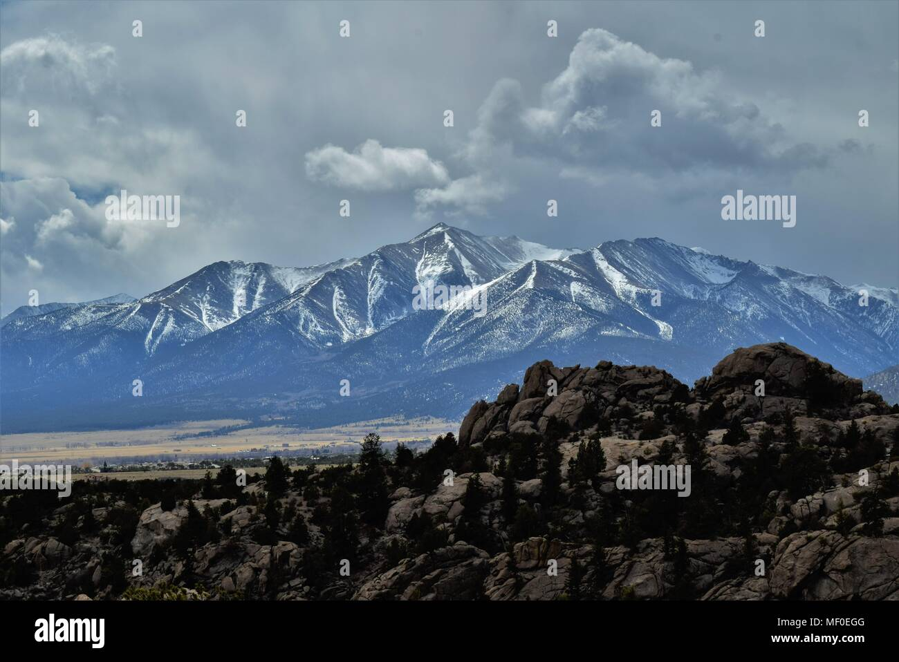 A partly cloudy sky with visible clear sky over snowcapped Mount Princeton (of The Collegiate Peaks mountain range) in beautiful Buena Vista, Colorado - Stock Image
