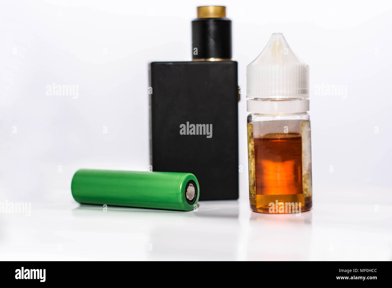 Personal Vaporizer with E liquid and battery - Stock Image