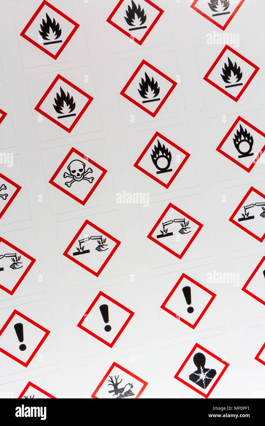 A sheet of various CLP Regulation/GHS chemical warning labels  including Oxidising, Flammable, Acute toxicity, Corrosive and Health Hazard. - Stock Image