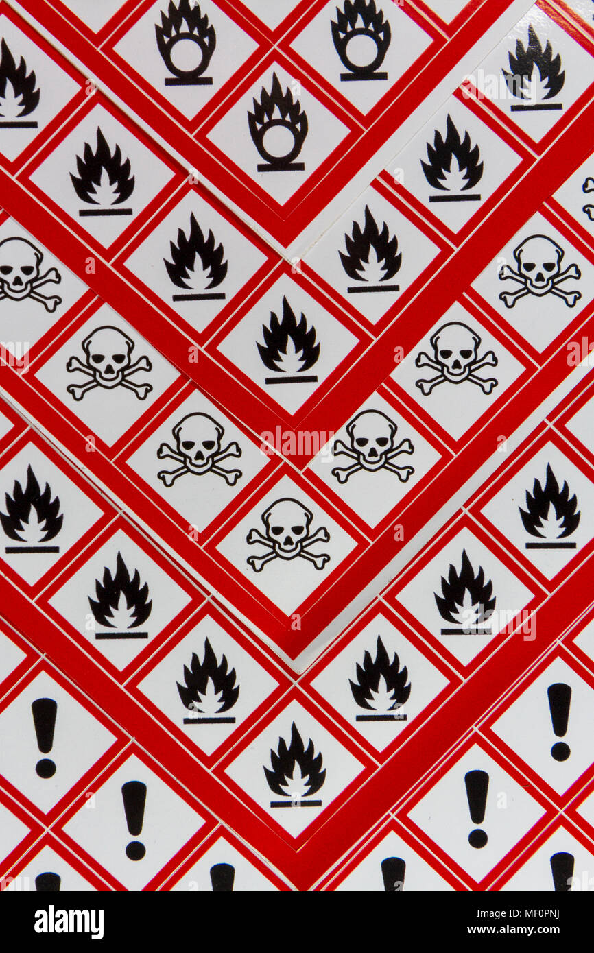 A sheet of various CLP Regulation/GHS chemical warning labels including Oxidising, Flammable, Acute toxicity and Health hazard. - Stock Image