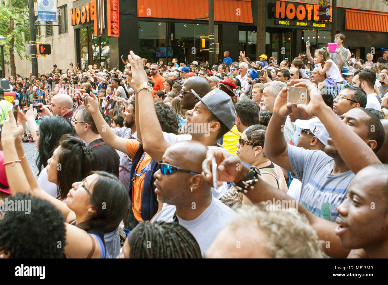 Atlanta, GA, USA - September 5, 2015: Thousands of people gathered on Peachtree Street watch the annual Dragon Con parade in Atlanta, GA. - Stock Image