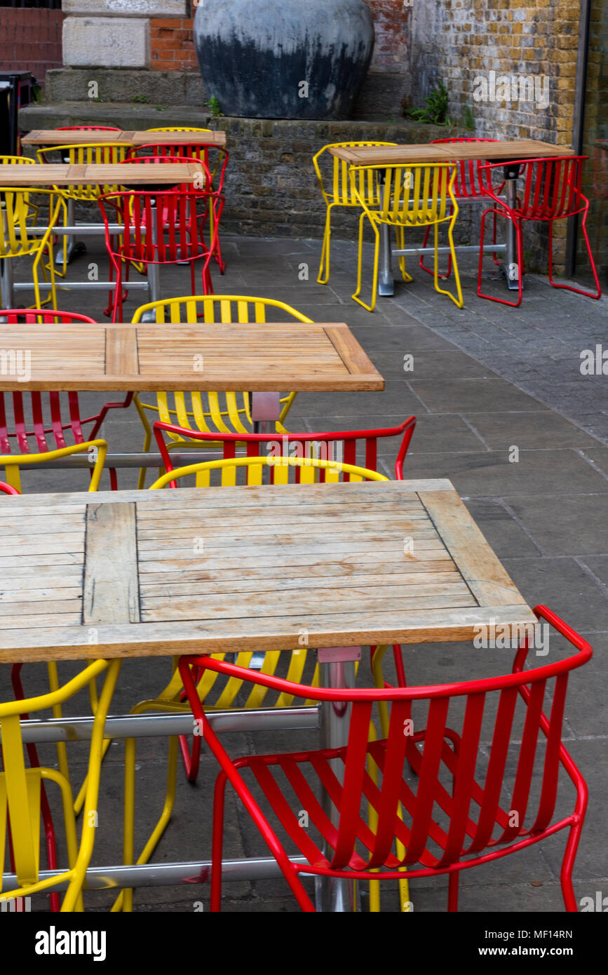 Yellow And Red Brightly Coloured Tables And Chairs At A Cafe Or Restaurant By The Side Of The River Thames In Central London Trendy Fashionable Cafe Stock Photo Alamy