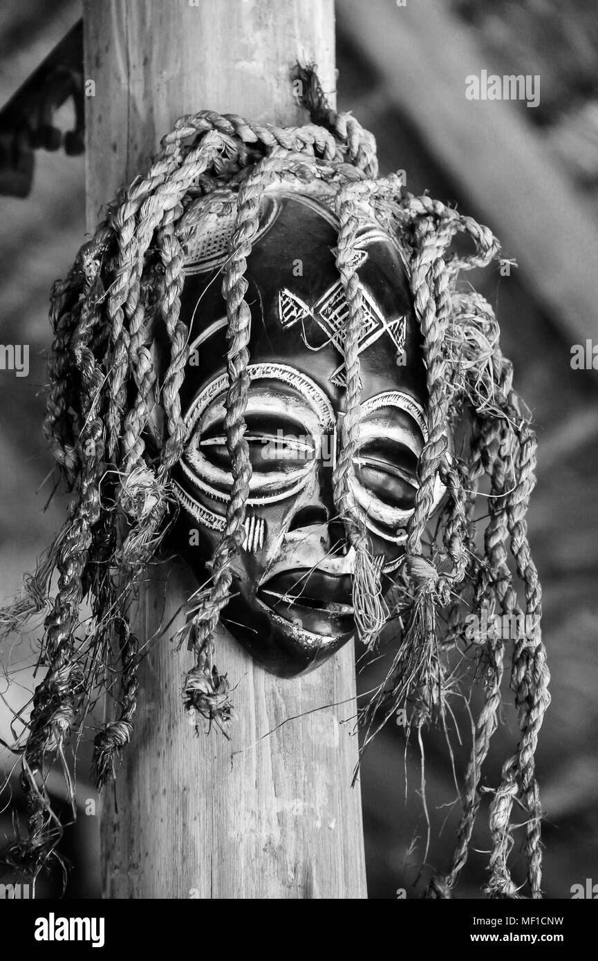 Black white image of tribal african wooden mask used in ceremonies such as weddings
