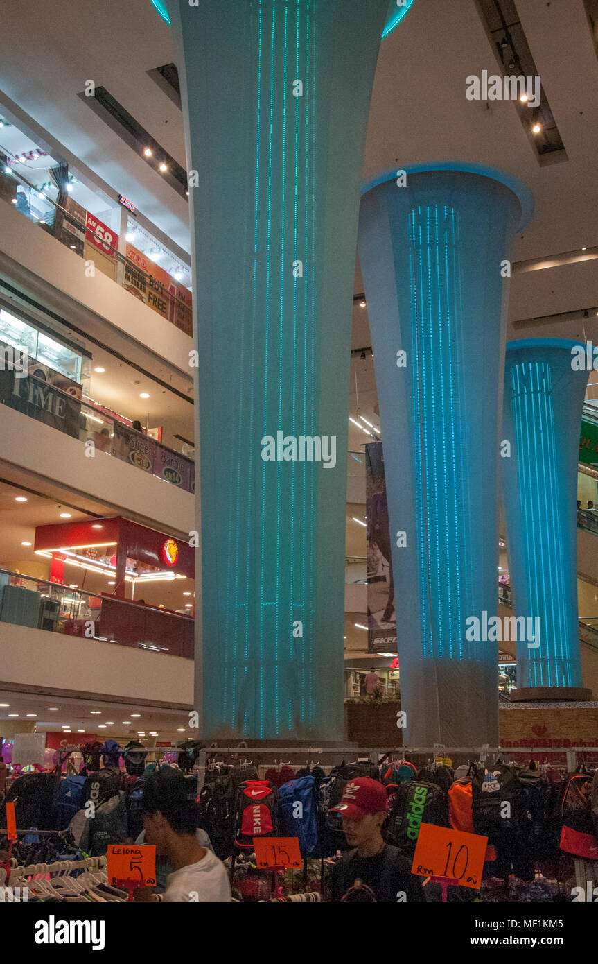 Busy weekend in a city shopping mall, Kota Kinabalu, Malaysian Borneo - Stock Image