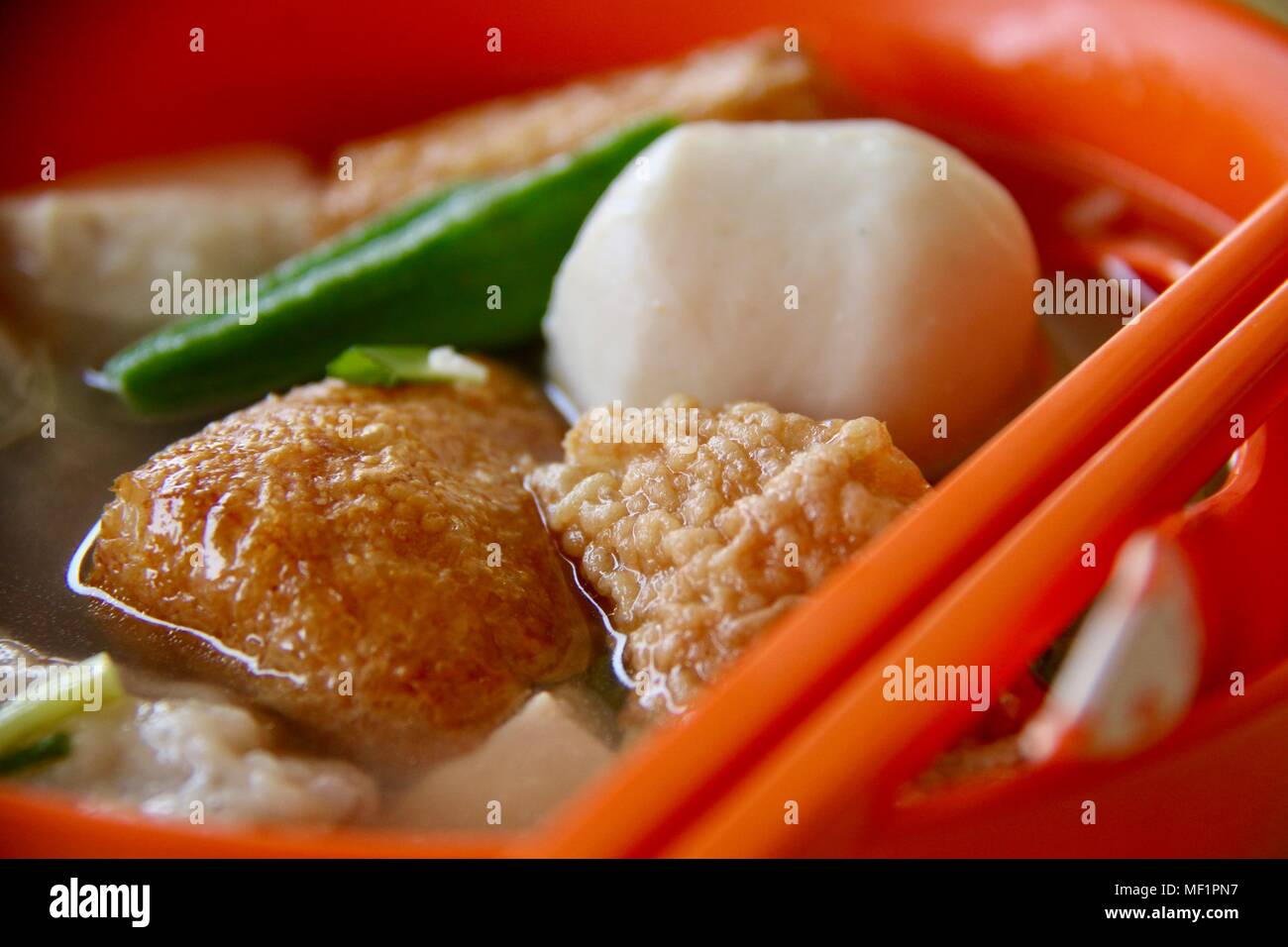 Yong Tau Foo. Chinese dish of stuffed bean curd, vegetable and fish cakes in hot broth. - Stock Image