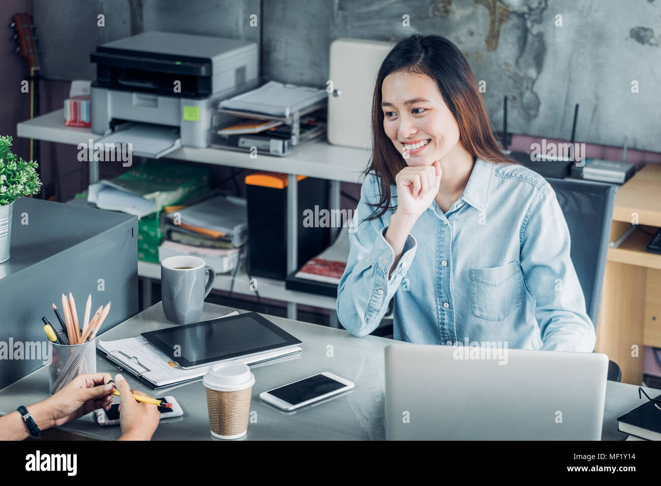 Two colleagues causal meeting at home office desk about business planing,business teamwork,top view of asian work mate consulting together - Stock Image