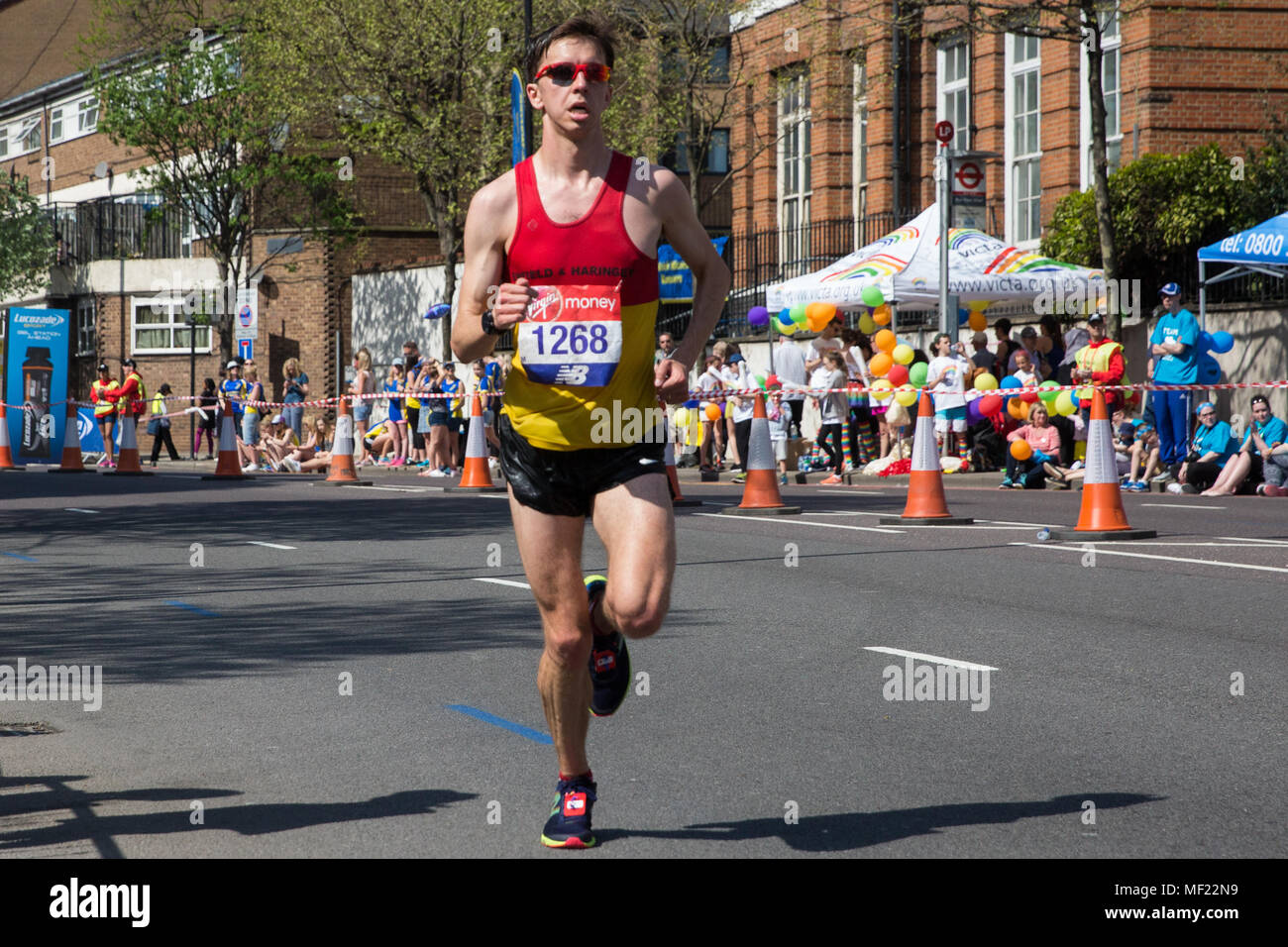 London, UK. 22nd April, 2018. Alex Milne of Enfield and Haringey AC competes in the 2018 Virgin Money London Marathon. The 38th edition of the race was the hottest on record with a temperature of 24.1C recorded in St James's Park. - Stock Image