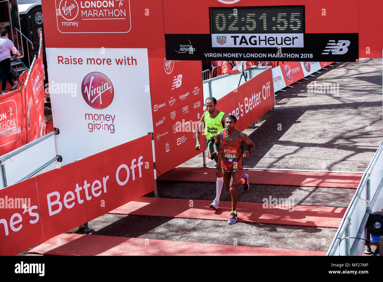 Jorge PINA crosses the finish line in Para-athletics Marathon World Cup for men para-athletes with visual impairment who run with a guide during the Virgin Money London Marathon in London, England on April 22, 2018. - Stock Image