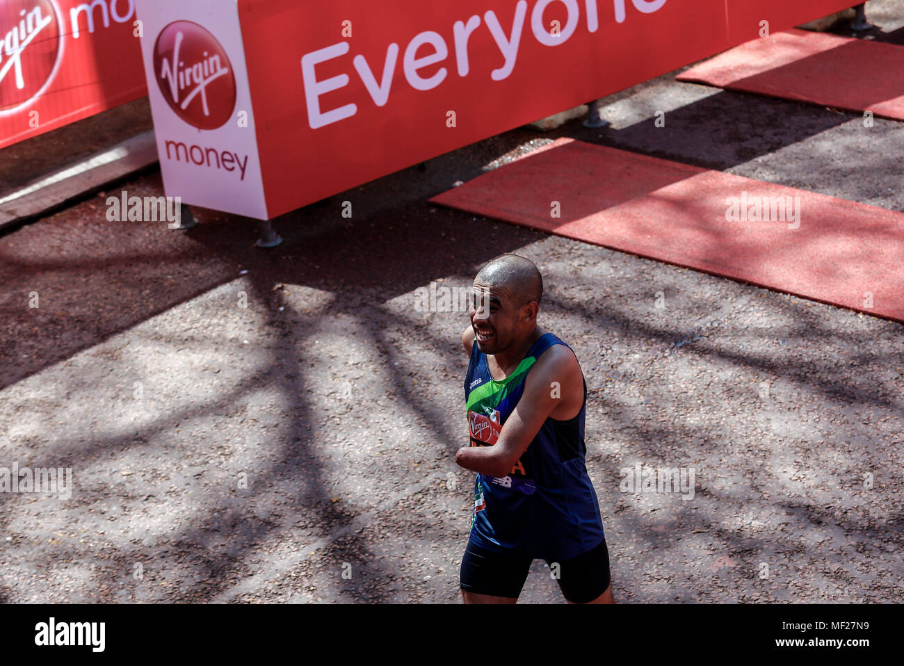 Pedro Meza at the finish line Para-athletics Marathon World Cup for men para-athletes with lower and upper limb impairments during the Virgin Money London Marathon in London, England on April 22, 2018. - Stock Image