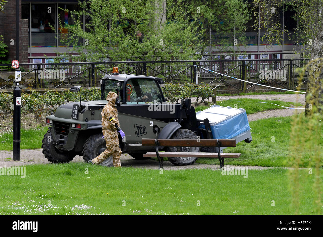 Salisbury, Wiltshire, UK. 24th April, 2018. Soldiers in breathing apparatus replacing the paving where Russian spy Sergei Skripal and his daughter collapsed after their nerve agent attack. Credit: Finnbarr Webster/Alamy Live News - Stock Image