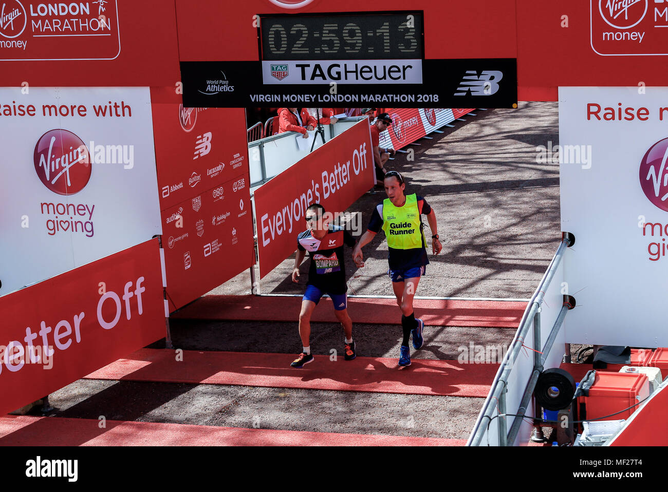 Nicolas BOMPARD crosses the finish line in Para-athletics Marathon World Cup for men para-athletes with visual impairment who run with a guide during the Virgin Money London Marathon in London, England on April 22, 2018. - Stock Image