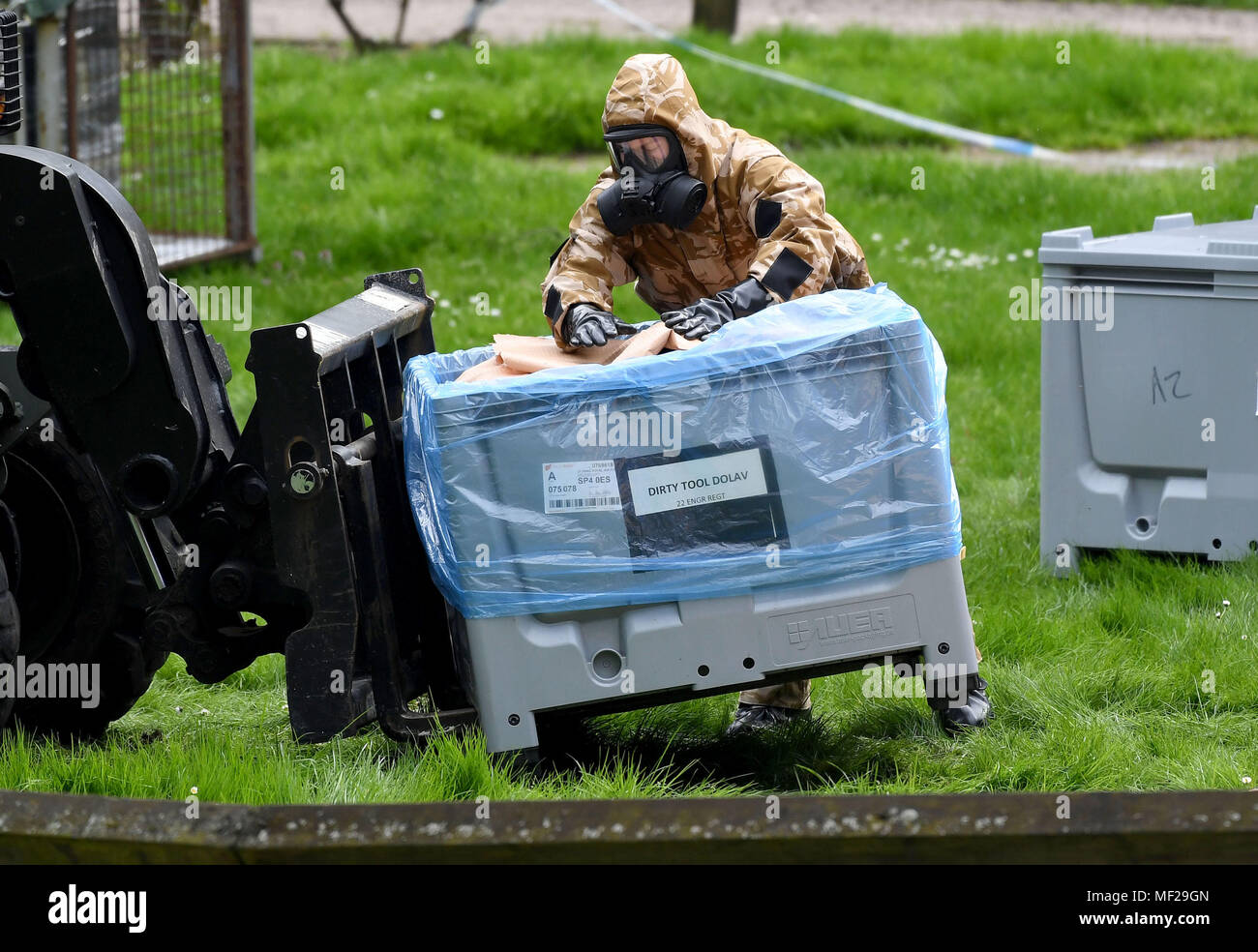 Salisbury, Wiltshire, UK. 24th Apr, 2018. Soldiers in breathing apparatus replacing the paving where Russian spy Sergei Skripal and his daughter collapsed after their nerve agent attack. Credit: Finnbarr Webster/Alamy Live News - Stock Image