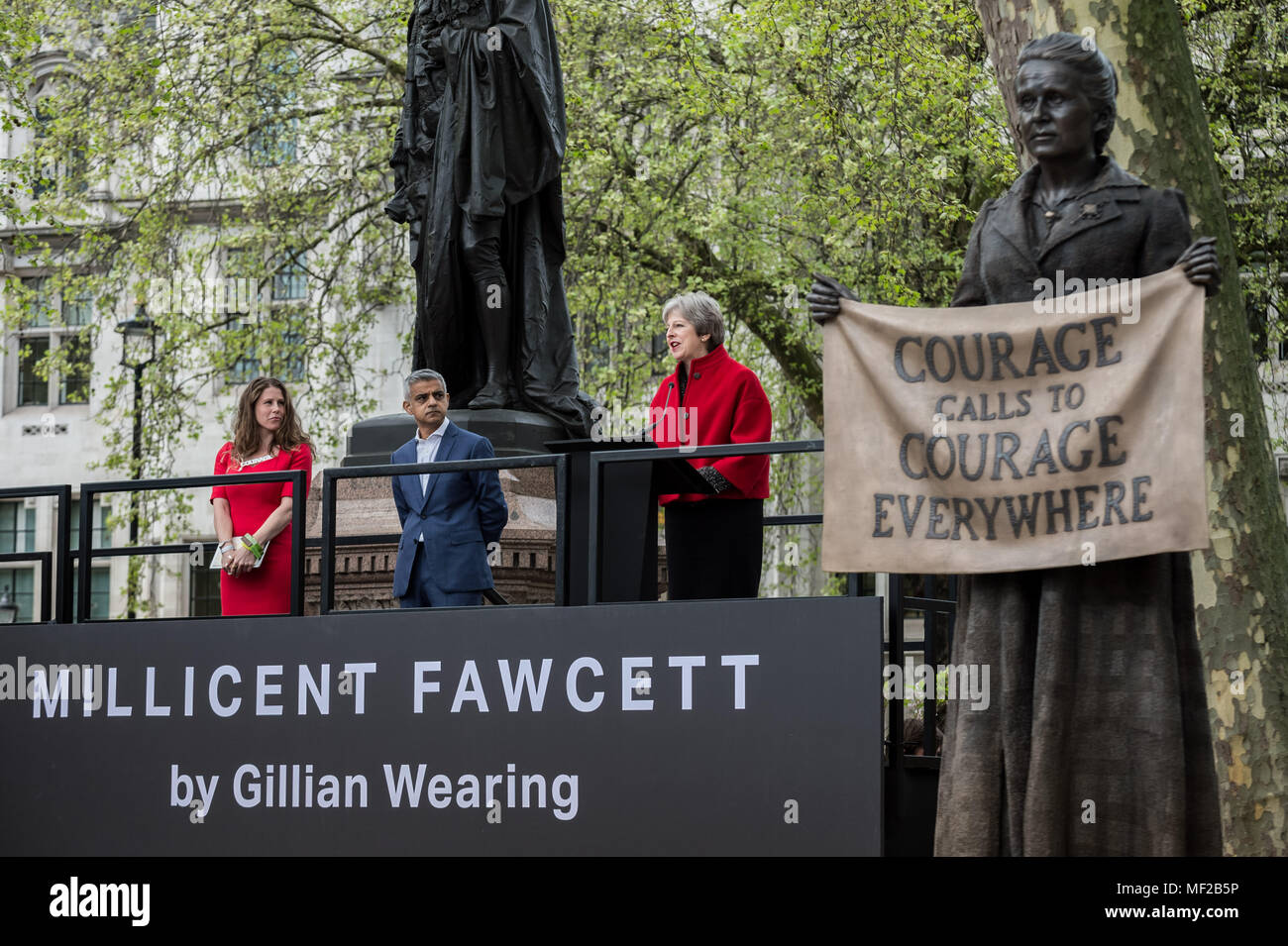 London, UK. 24th April, 2018. Statue of Millicent Fawcett is unveiled in Parliament Square. Caroline Criado-Perez, Theresa May and Sadiq Khan attended the unveiling ceremony. The first statue of a woman in Parliament Square joins the line-up of male figures to mark the centenary of women's suffrage in Britain - two years after the campaign to get female representation outside the Palace of Westminster began. Credit: Guy Corbishley/Alamy Live News - Stock Image