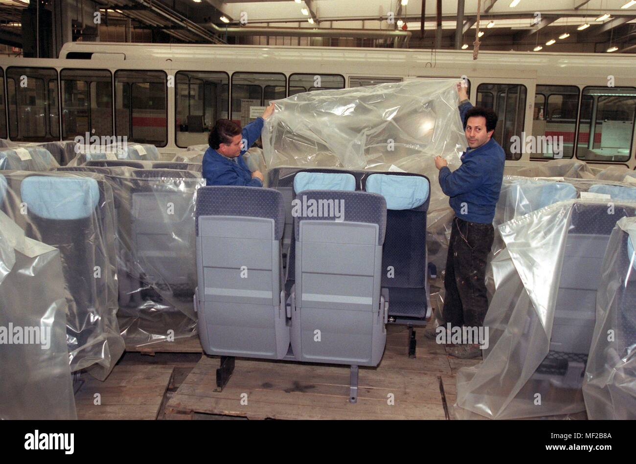View into a workshop of the company Duewag in Krefeld-Uerdingen, in which 17.3.1998 ICE seats are packed. On 18.3. is celebrating the 100th birthday of the 'Dusseldorf-Uerdinger Wagon Factory' - now part of the Siemens Group. With an order backlog of two billion DM, the Duewag breaks all its own records. Instead of 200 cars so far, 400 railway vehicles 'made in Uerdingen' are to be put on the rails every year. | usage worldwide - Stock Image