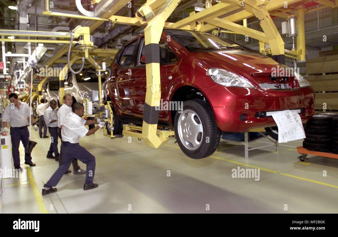 A Brazilian Daimler Chrysler Employee Assembles The Wheels On 2341999 Mercedes