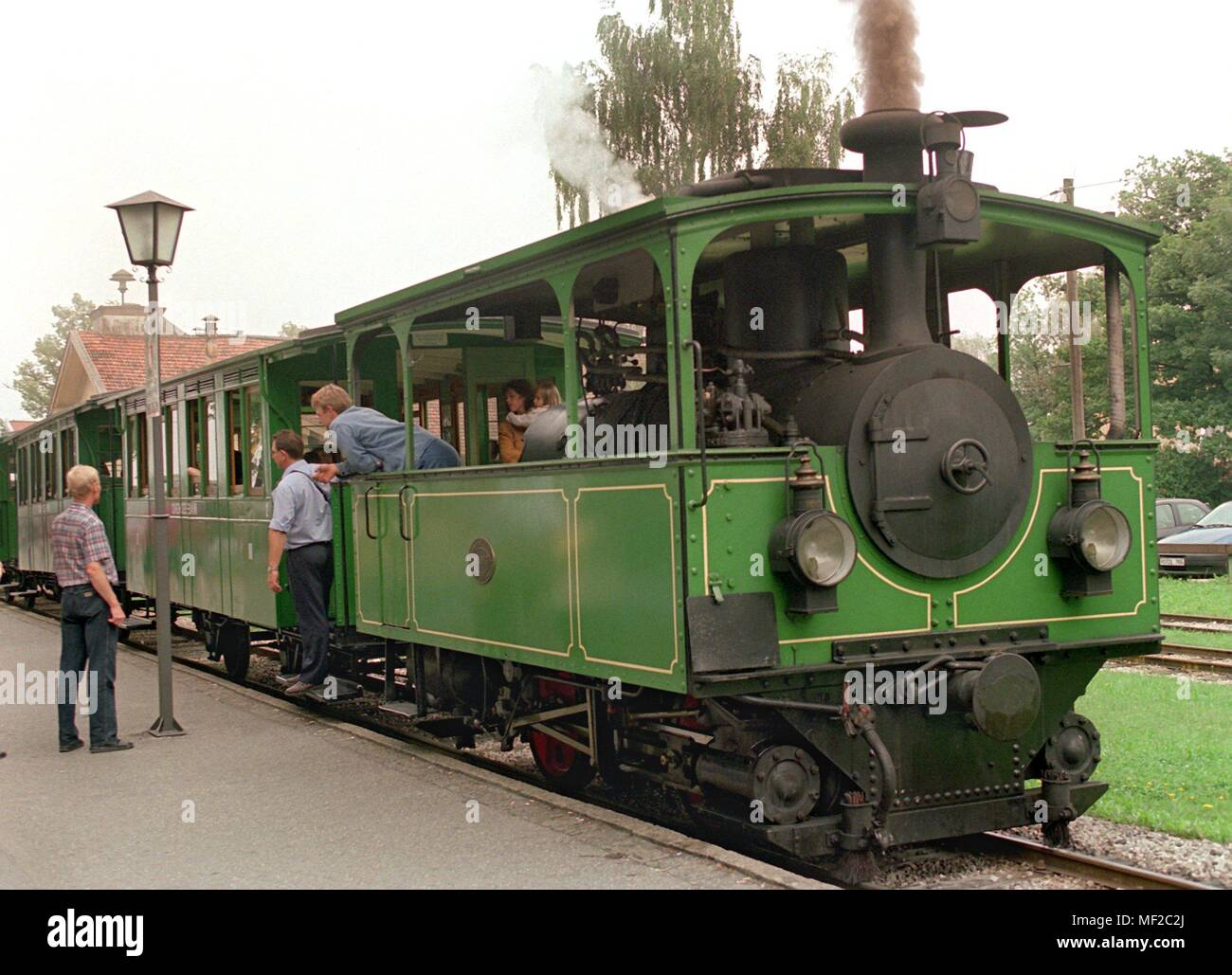 A functioning technical monument is the nostalgic Chiemseebahn, which steams on passengers in the harbor area of Stock am Chiemsee on 4.8.1998. The 111-year railway line connects the station of Prien with the dock of the Chiemsee ships in the district of Stock. The locomotive, a tramway locomotive, is the last of its kind in regular service. Once these machines, as precursors of the electric tram, were moving through the big cities. Due to the high maintenance costs, this tourist attraction is at the end of this season threatened by the setting. | usage worldwide Stock Photo