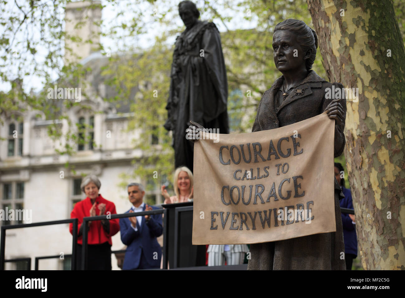 Westminster, London, UK, 24th April 2018, Unveiling of the Millicent Fawcett statue in Parliament Square, PM Theresa May and London's Mayor Sadiq Khan standby the unveiled statue of Millicent Fawcett, Credit: Richard Soans/Alamy Live News - Stock Image