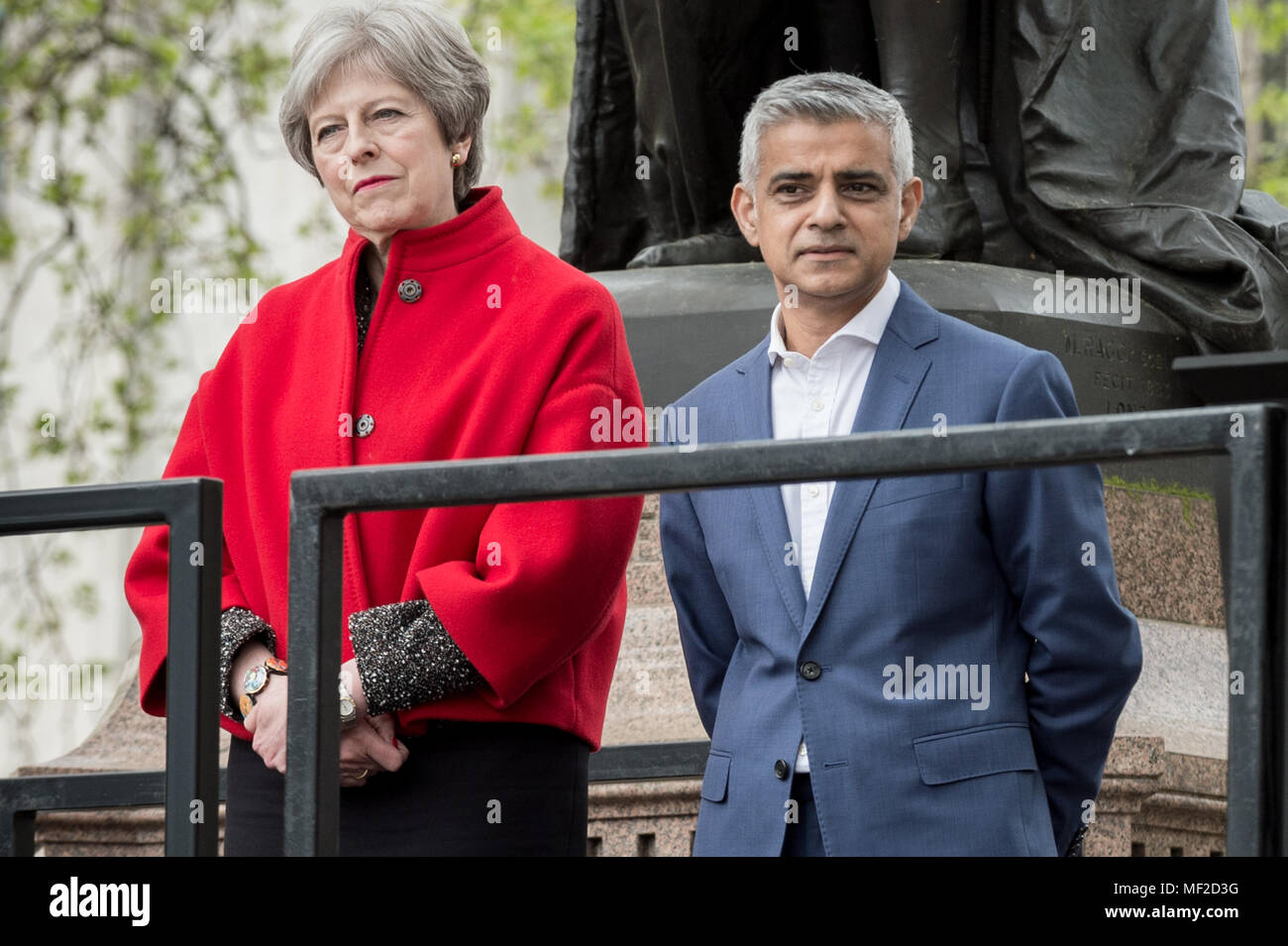 London, UK. 24th April, 2018. Theresa May and Sadiq Khan during the unveiling ceremony of Millicent Fawcett in Parliament Square. The first statue of a woman in Parliament Square joins the line-up of male figures to mark the centenary of women's suffrage in Britain - two years after the campaign to get female representation outside the Palace of Westminster began. Credit: Guy Corbishley/Alamy Live News - Stock Image
