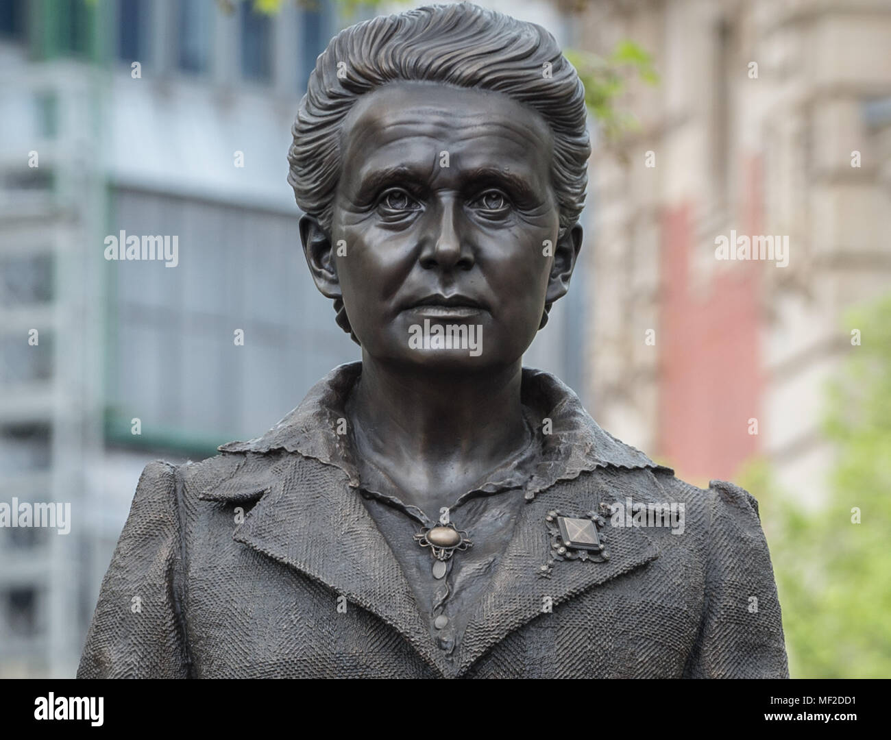 London, UK. 24th April, 2018. Statue of Millicent Fawcett is finally unveiled in Parliament Square. The first statue of a woman in Parliament Square joins the line-up of male figures to mark the centenary of women's suffrage in Britain - two years after the campaign to get female representation outside the Palace of Westminster began. Credit: Guy Corbishley/Alamy Live News - Stock Image