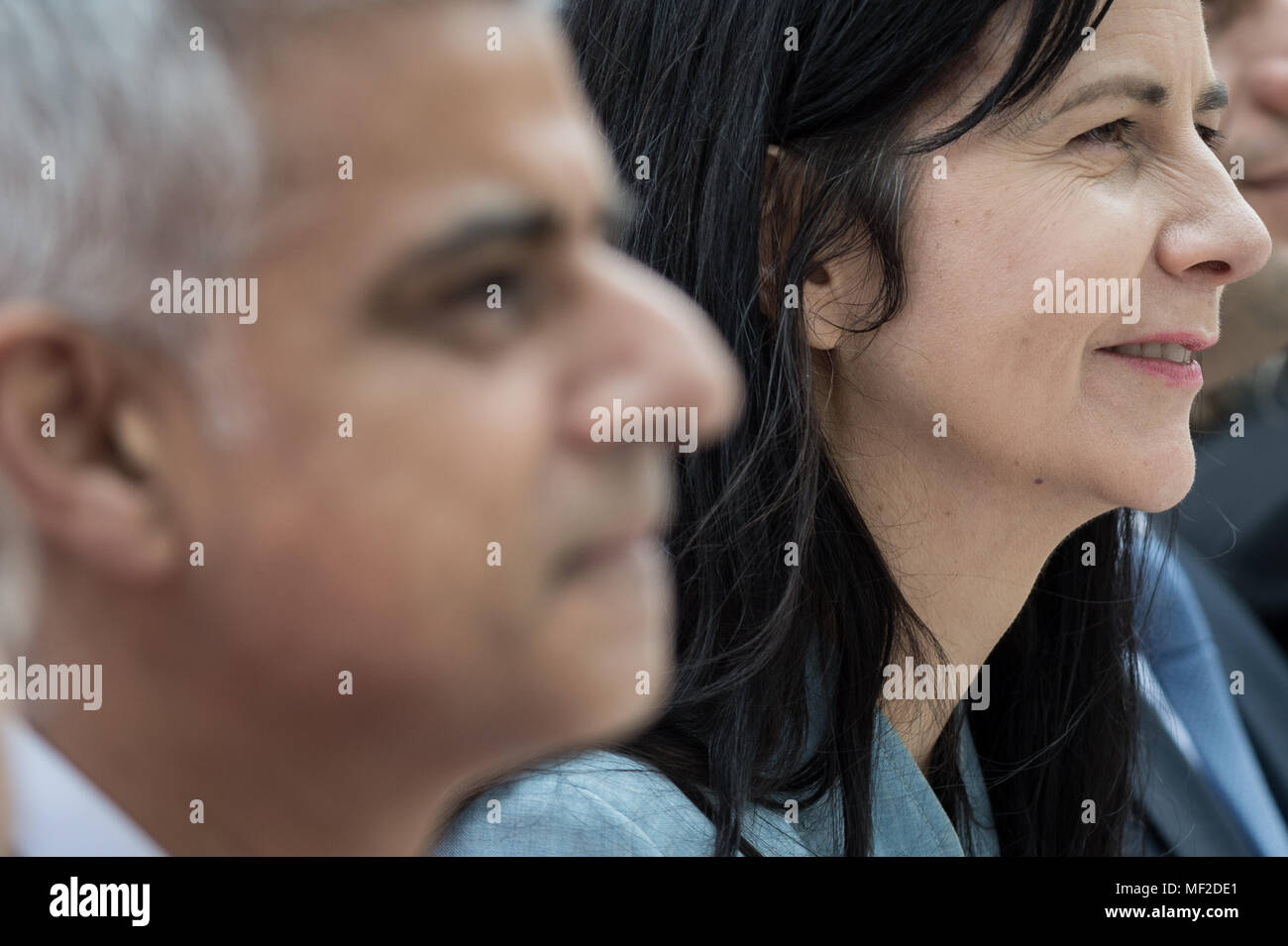 London, UK. 24th April, 2018. Statue creator, Gillian Wearing (right) sits with Mayor of London, Saduq Khan(left), during the unveiling ceremony of Millicent Fawcett in Parliament Square. The first statue of a woman in Parliament Square joins the line-up of male figures to mark the centenary of women's suffrage in Britain - two years after the campaign to get female representation outside the Palace of Westminster began. Credit: Guy Corbishley/Alamy Live News - Stock Image