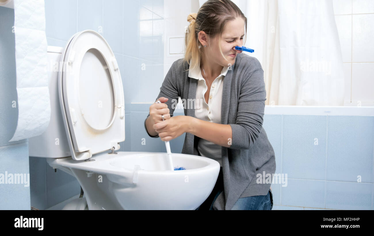 Remarkable Portrait Of Young Woman Feeling Disgust And Bad Smell Download Free Architecture Designs Salvmadebymaigaardcom